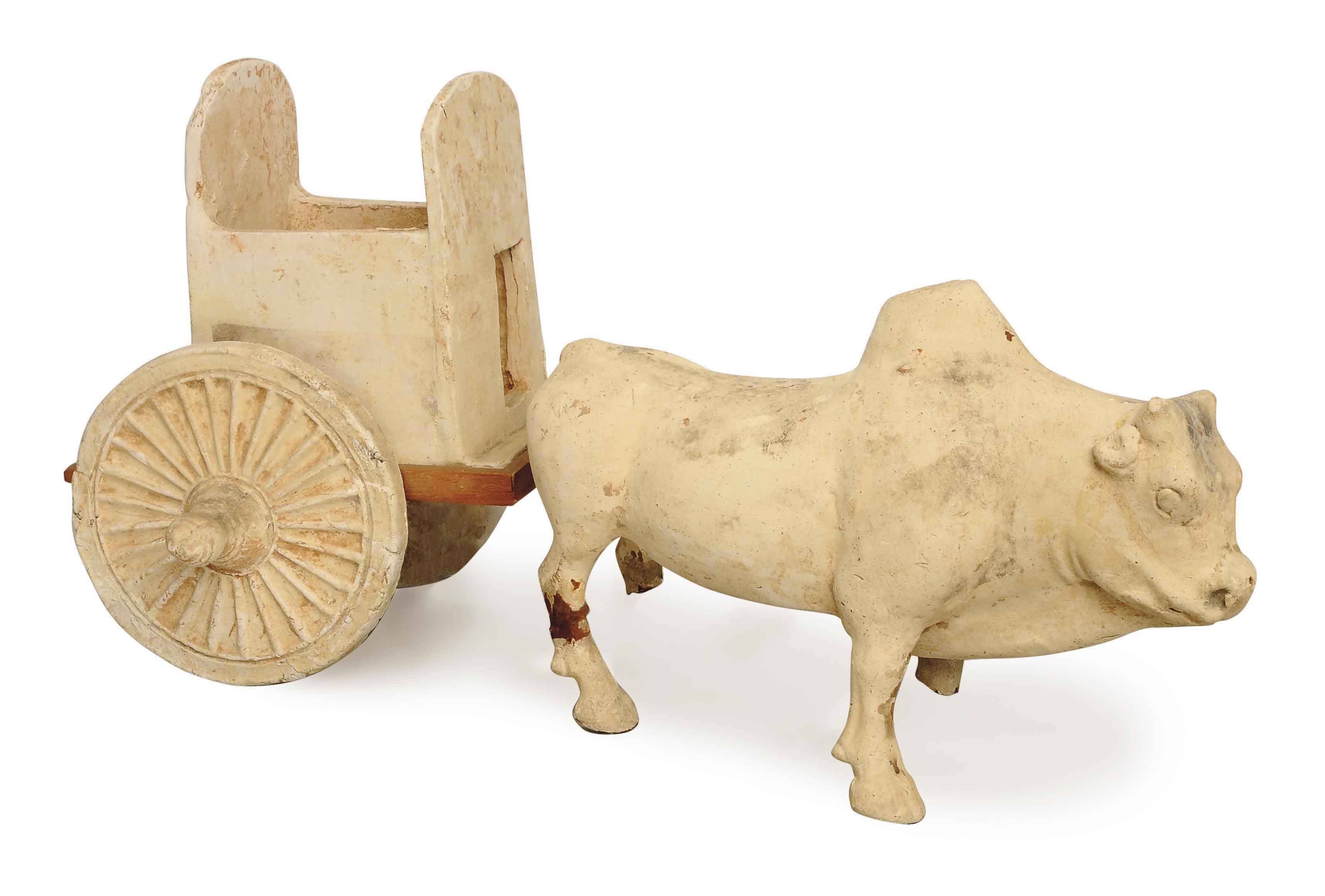 A CHINESE POTTERY MODEL OF AN OX AND CART,