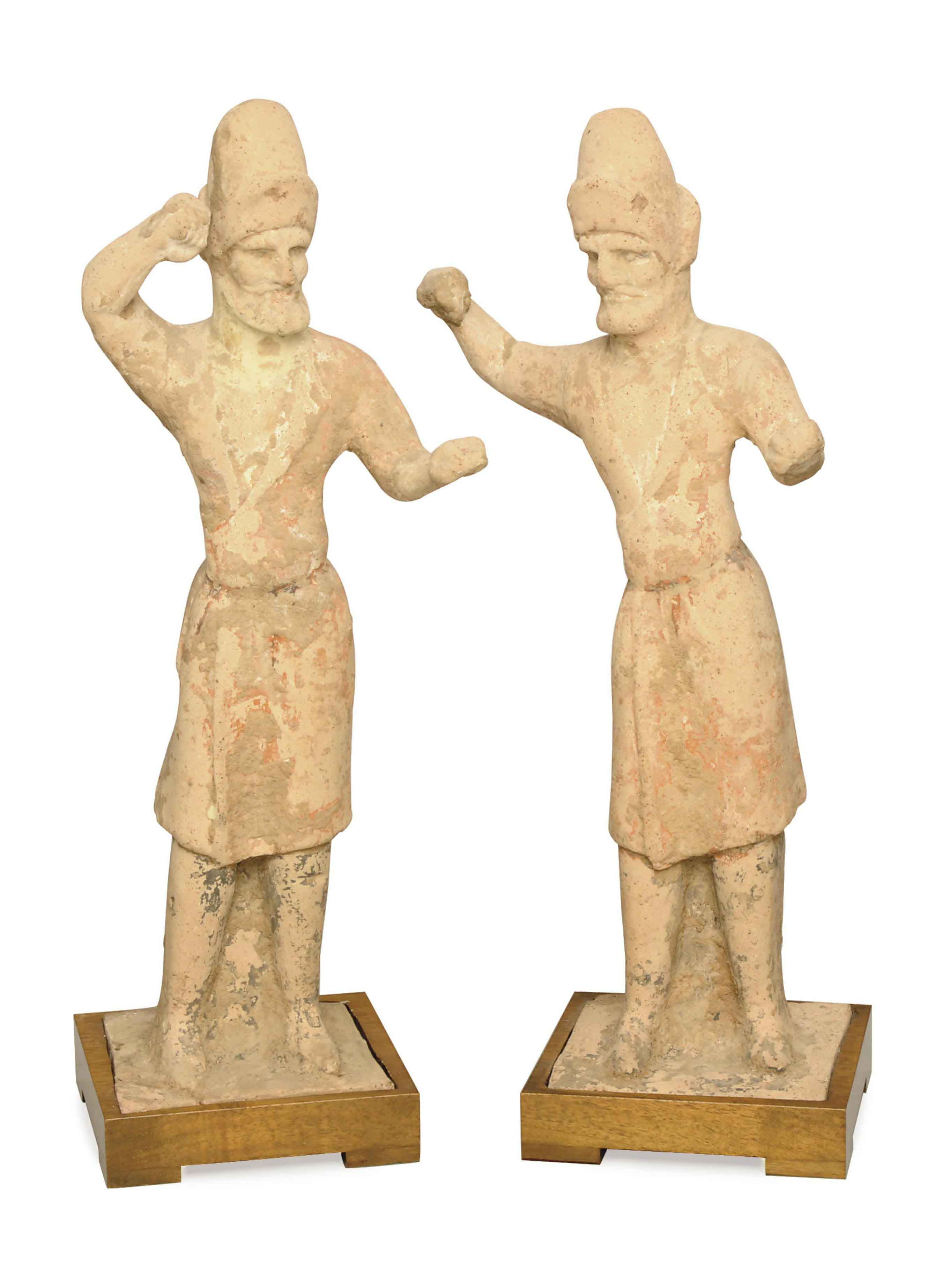 TWO CHINESE PAINTED POTTERY FIGURES OF GROOMS,