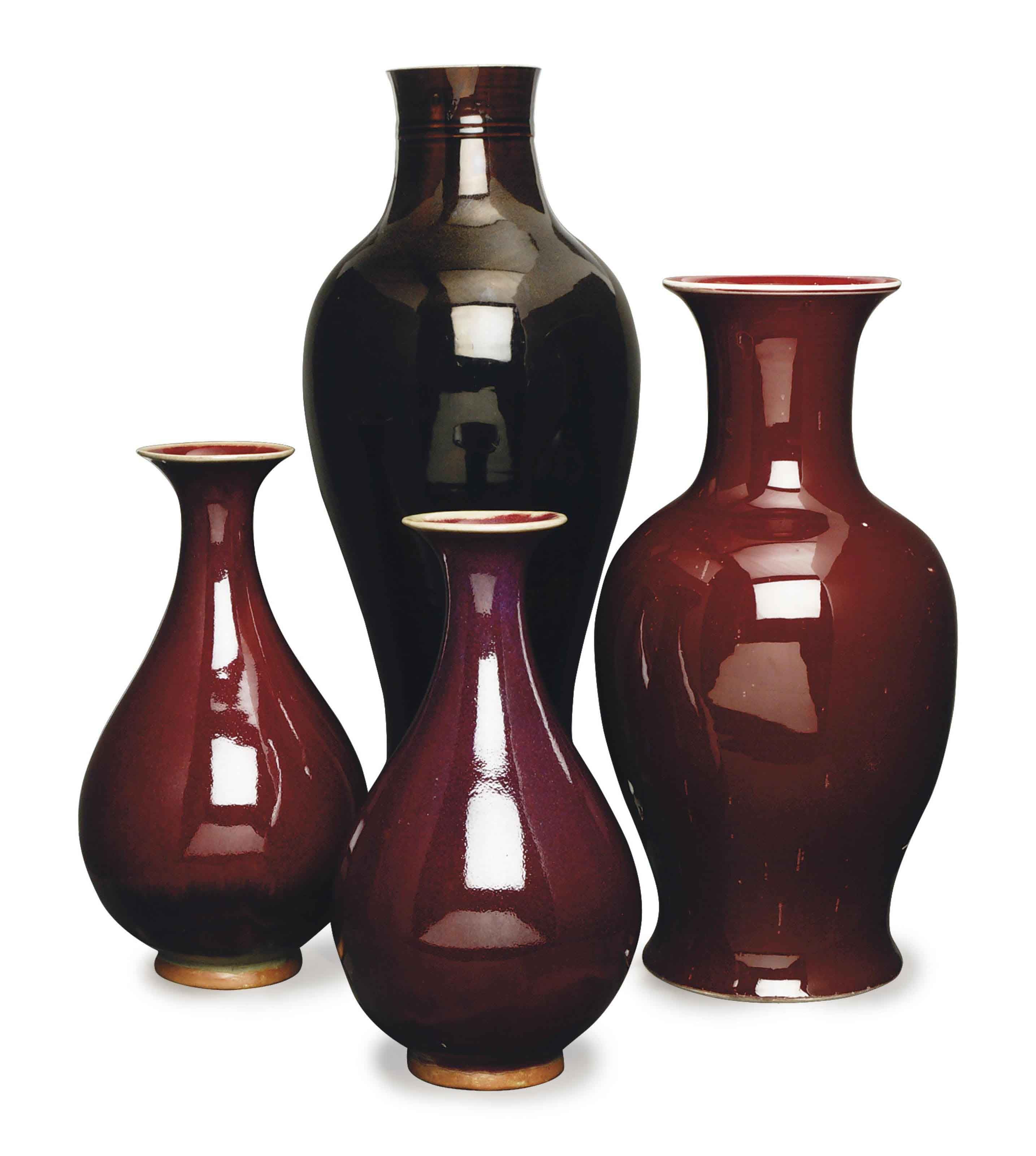 A CHINESE RED GLAZED VASE, AND A PAIR OF FLAMBE GLAZED VASES,