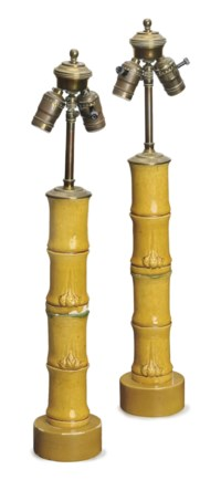 A PAIR OF AMBER-GLAZED EARTHENWARE FAUX BAMBOO TABLE LAMPS,