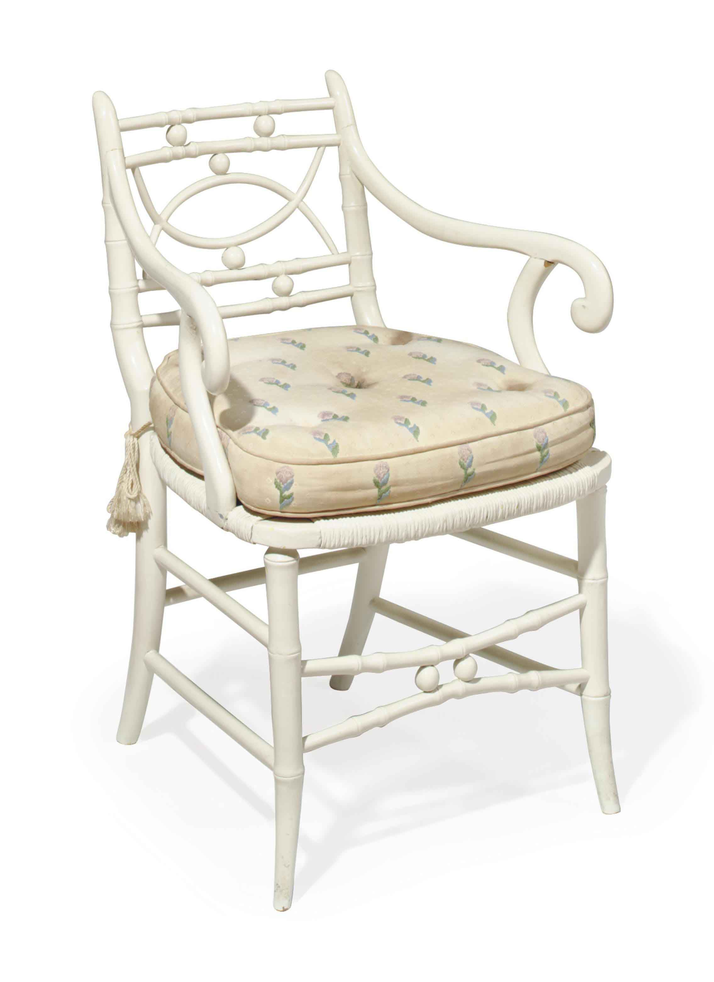 A WHITE-PAINTED FAUX-BAMBOO AND RATTAN OPEN ARMCHAIR,
