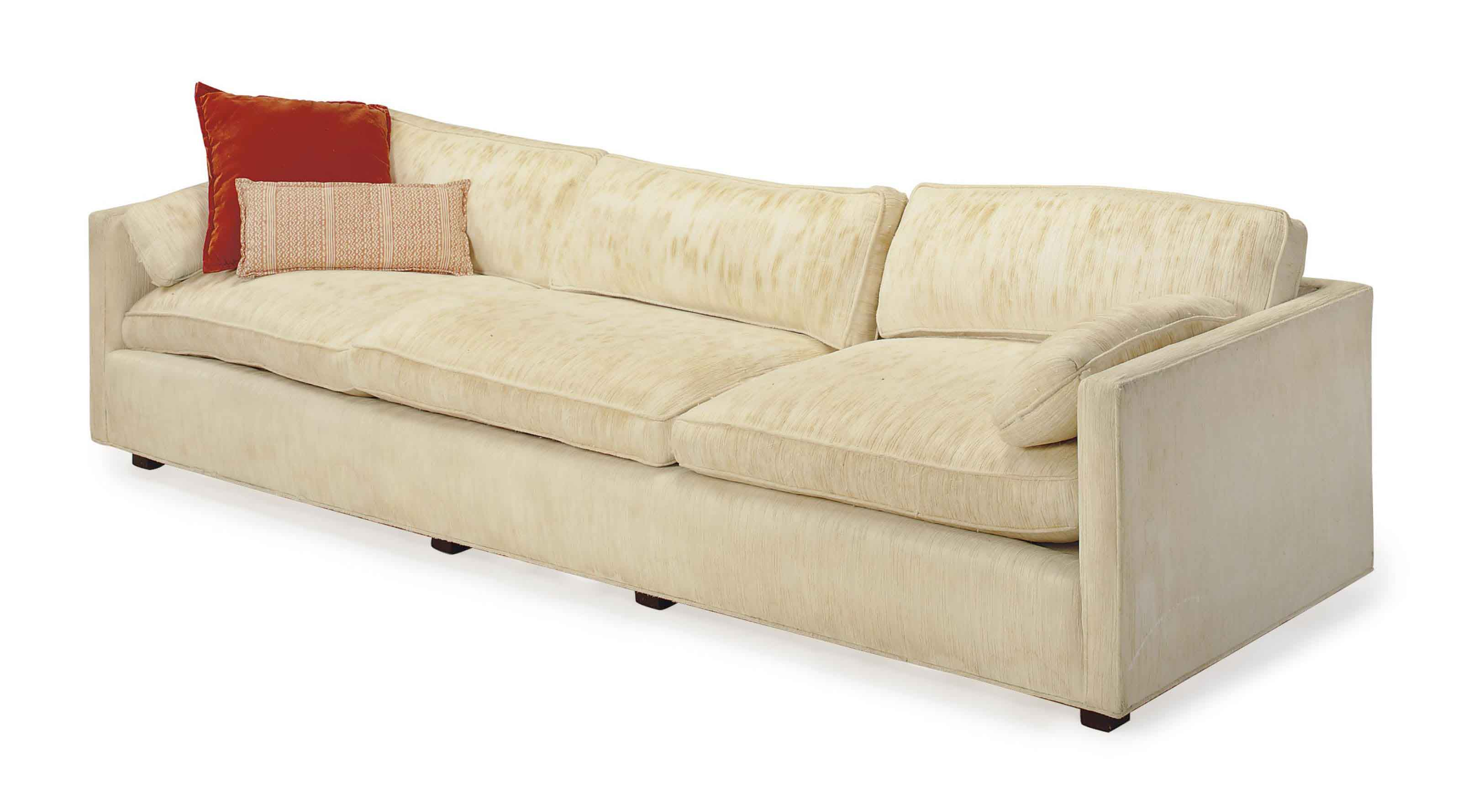 A CREAM TEXTURED COTTON AND VELOUR UPHOLSTERED SOFA,