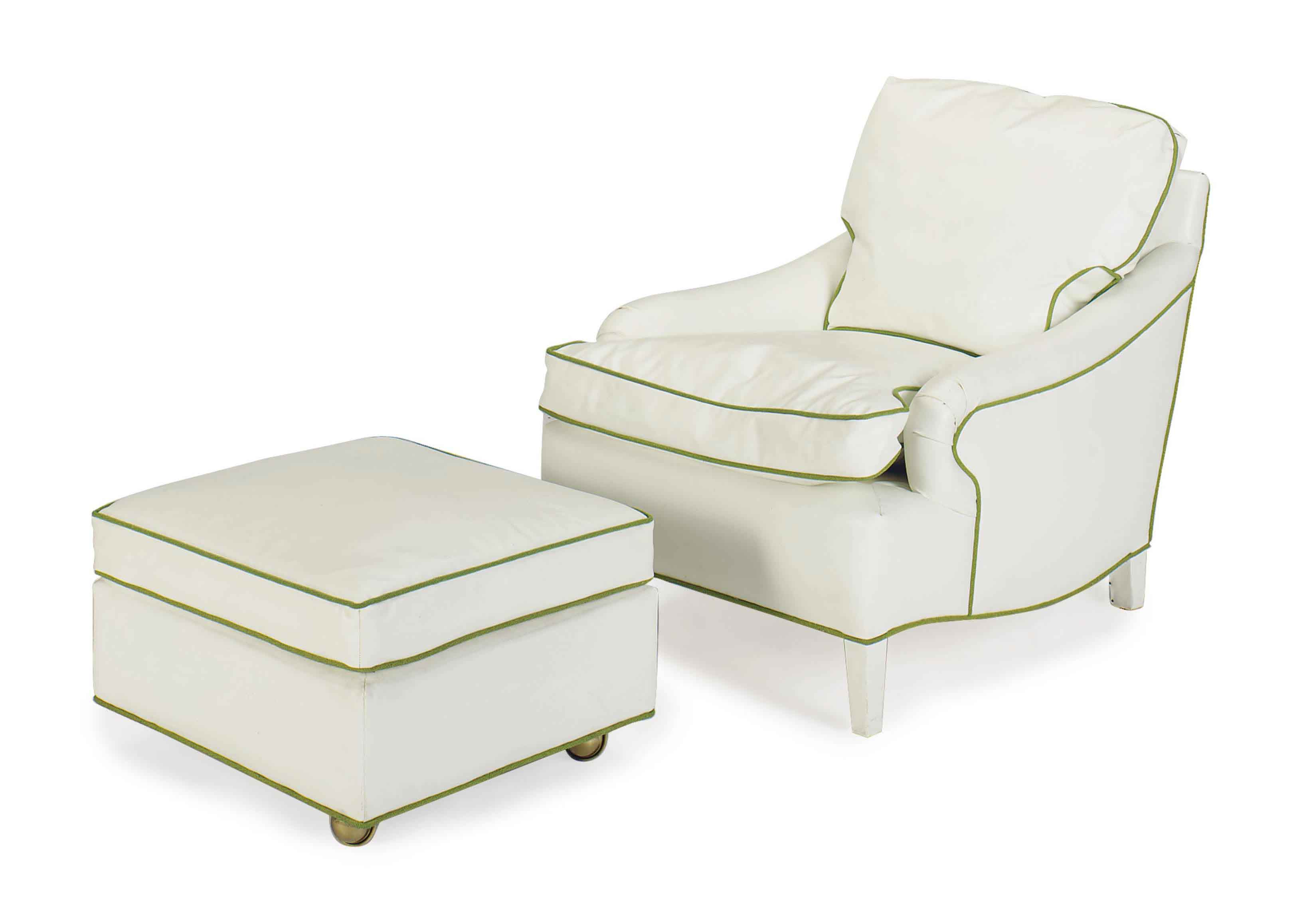 A WHITE VINYL-UPHOLSTERED CLUB CHAIR AND OTTOMAN,