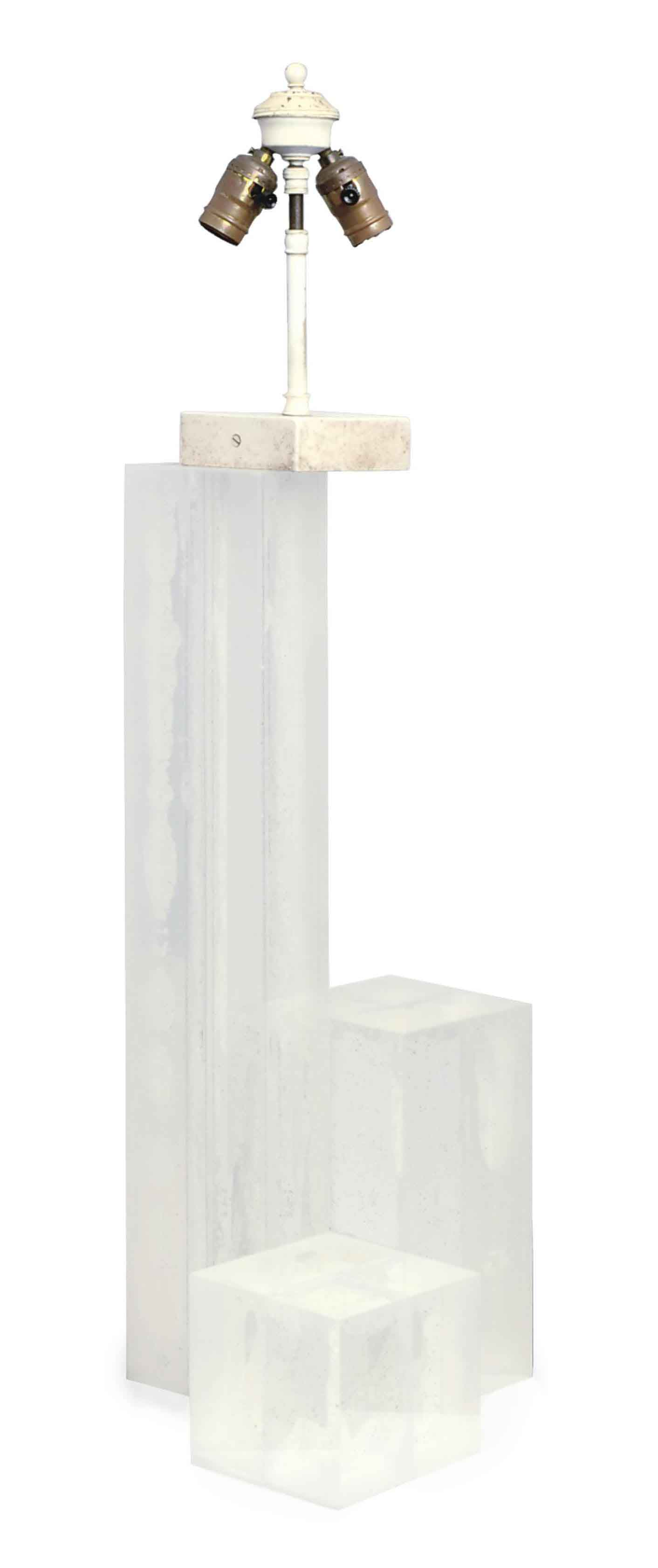 A TIERED LUCITE TABLE LAMP,