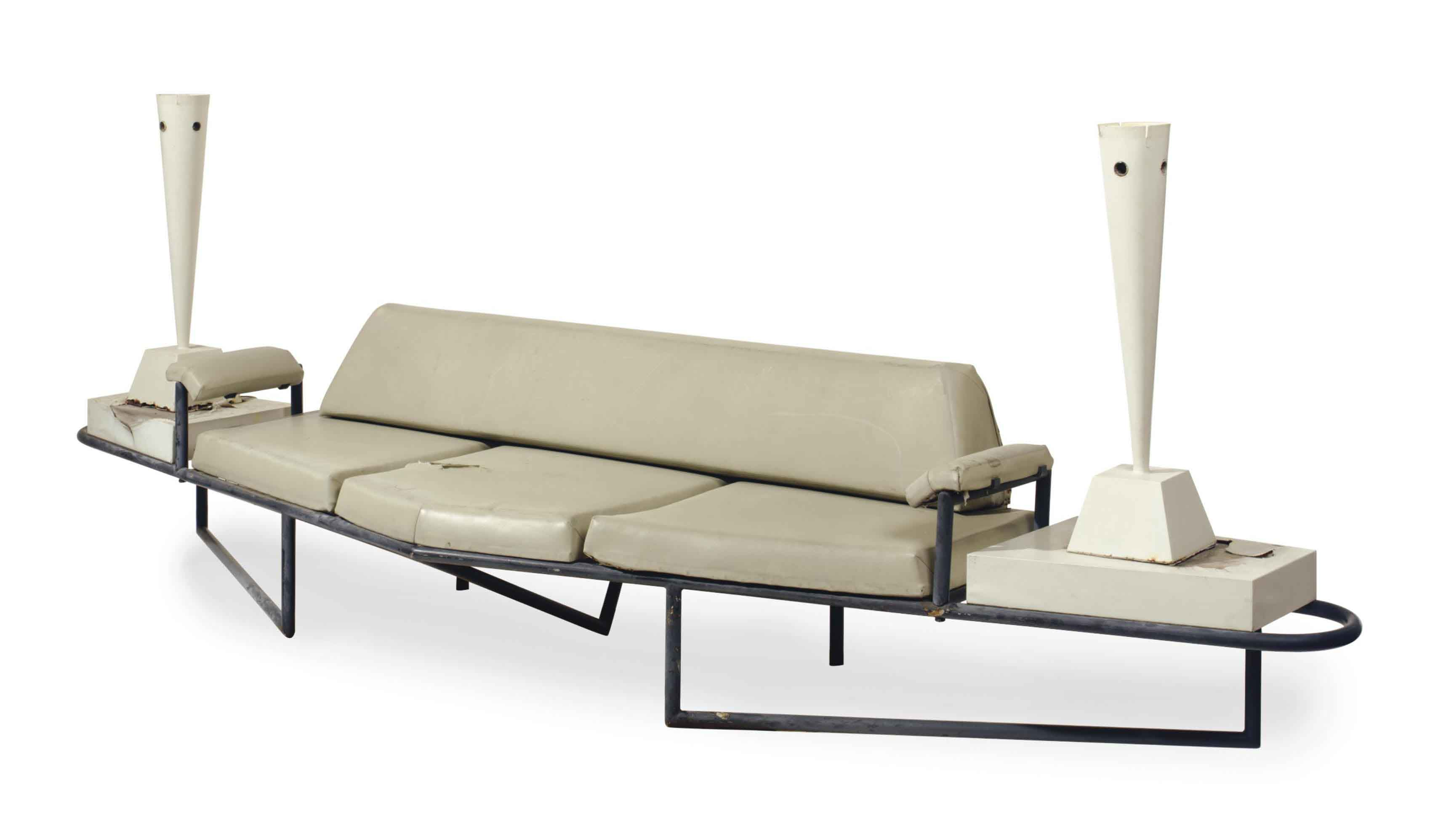 A PATINATED-METAL AND VINYL-COVERED SOFA,