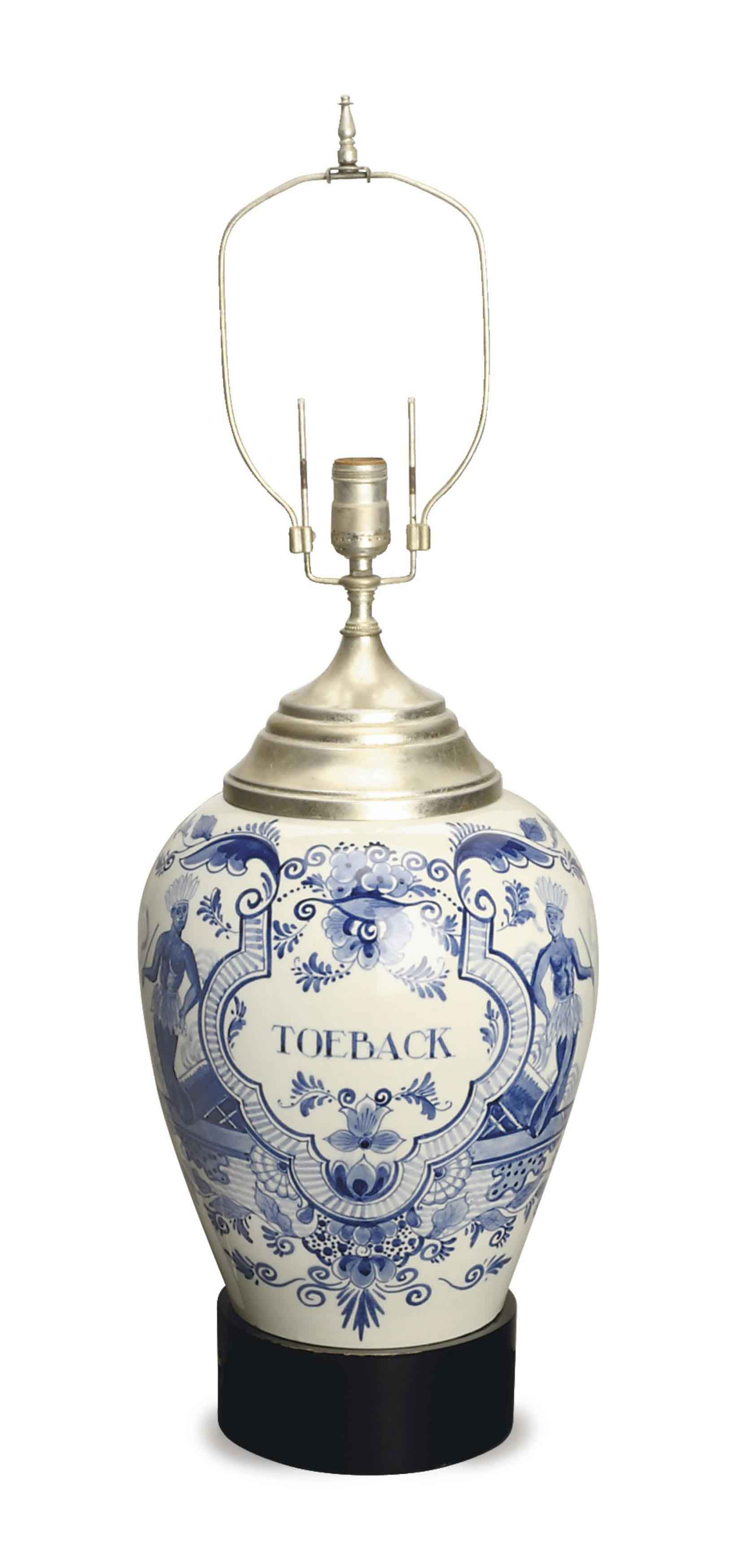 A DUTCH DELFT TOBACCO JAR MOUNTED AS A TABLE LAMP,