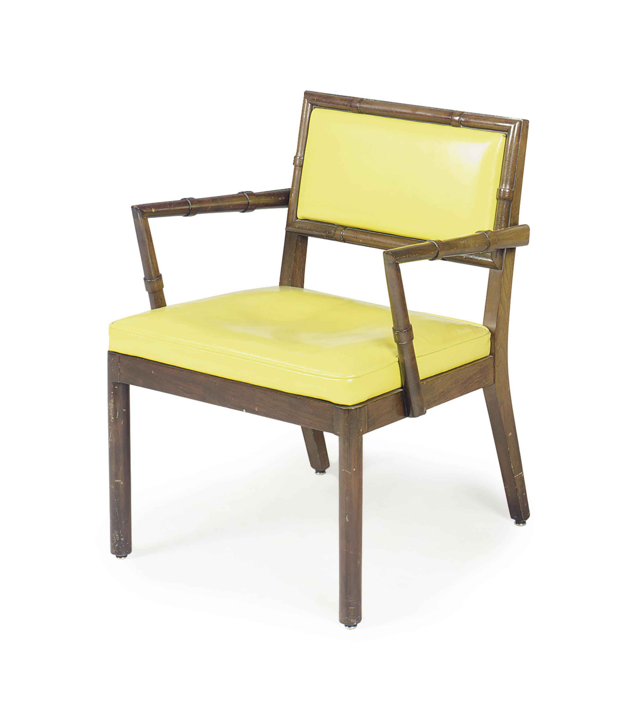 A YELLOW VINYL AND STAINED WALNUT OPEN ARMCHAIR,