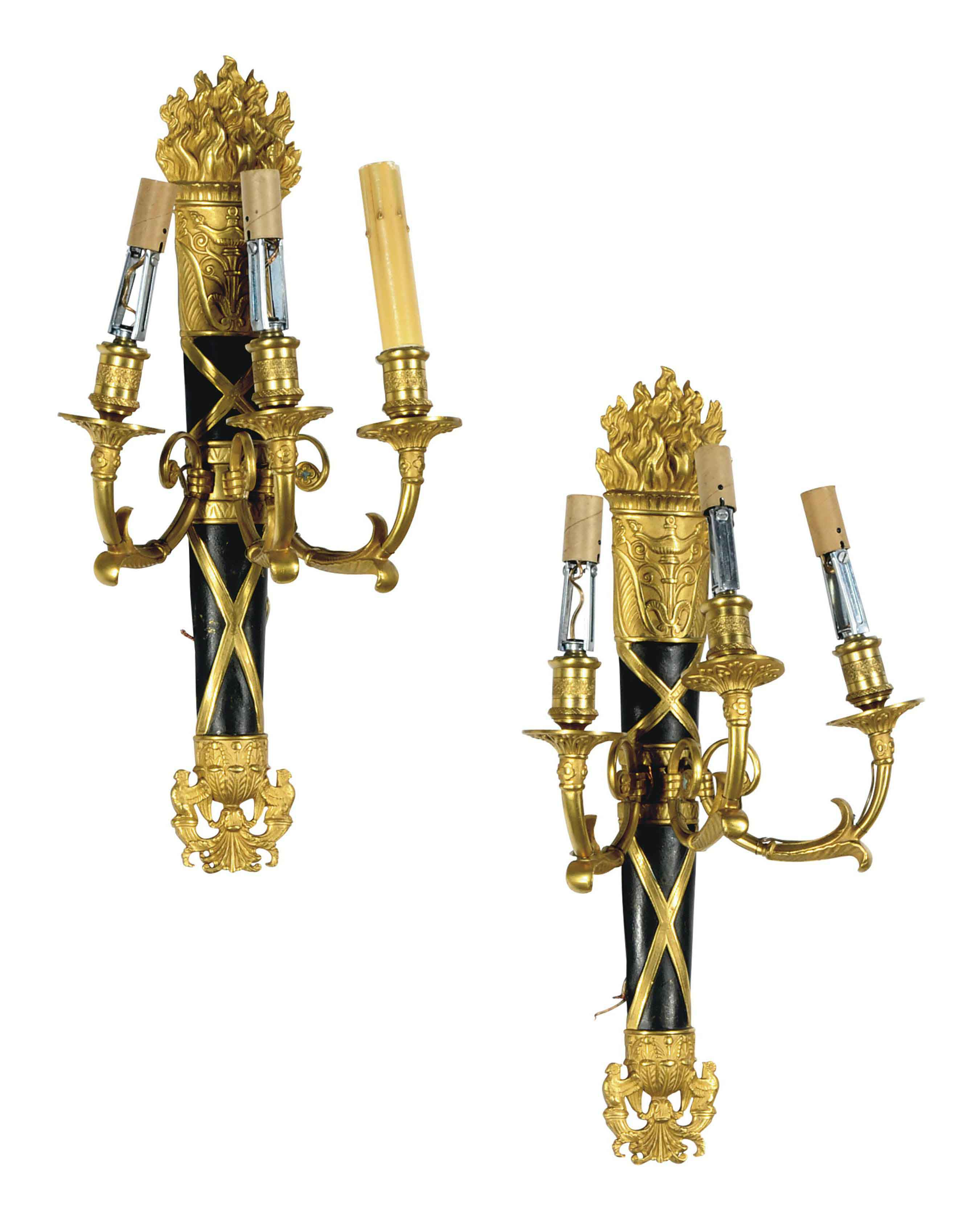 A PAIR OF FRENCH PATINATED AND GILT-BRONZE THREE-LIGHT WALL-LIGHTS,