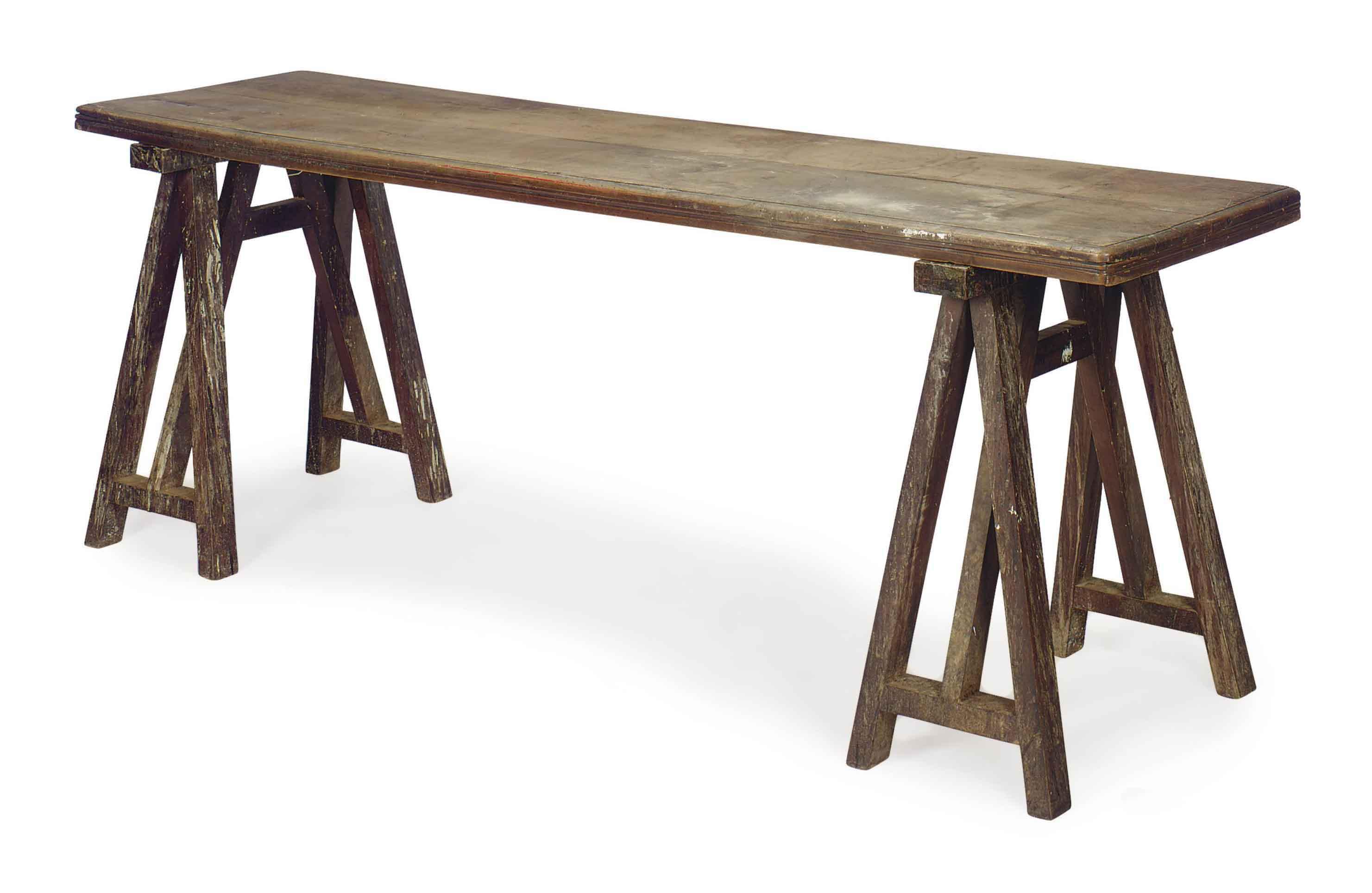 AN ITALIAN WALNUT TRESTLE BASE REFECTORY TABLE,