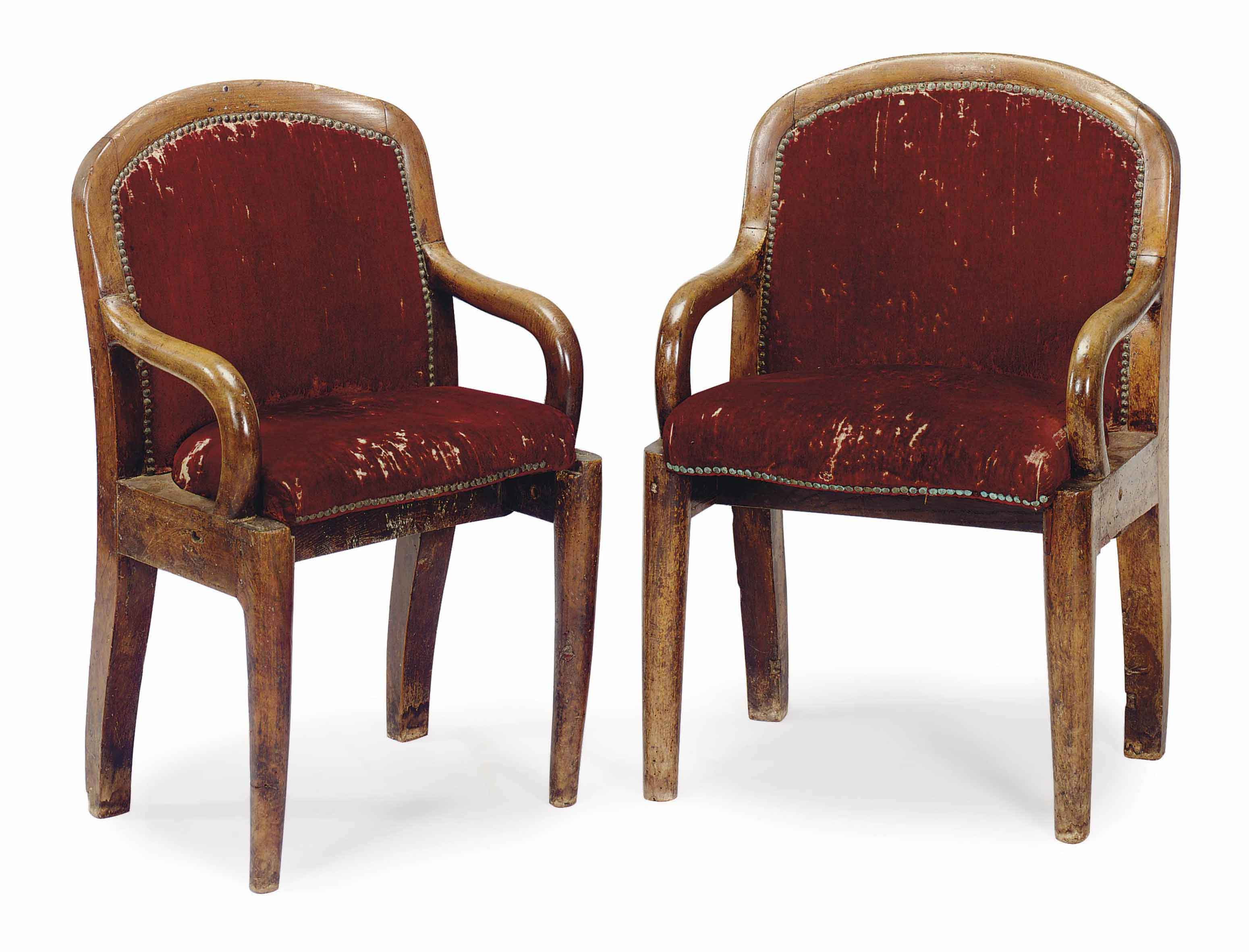 A PAIR OF FRENCH WALNUT CINEMA ARMCHAIRS,
