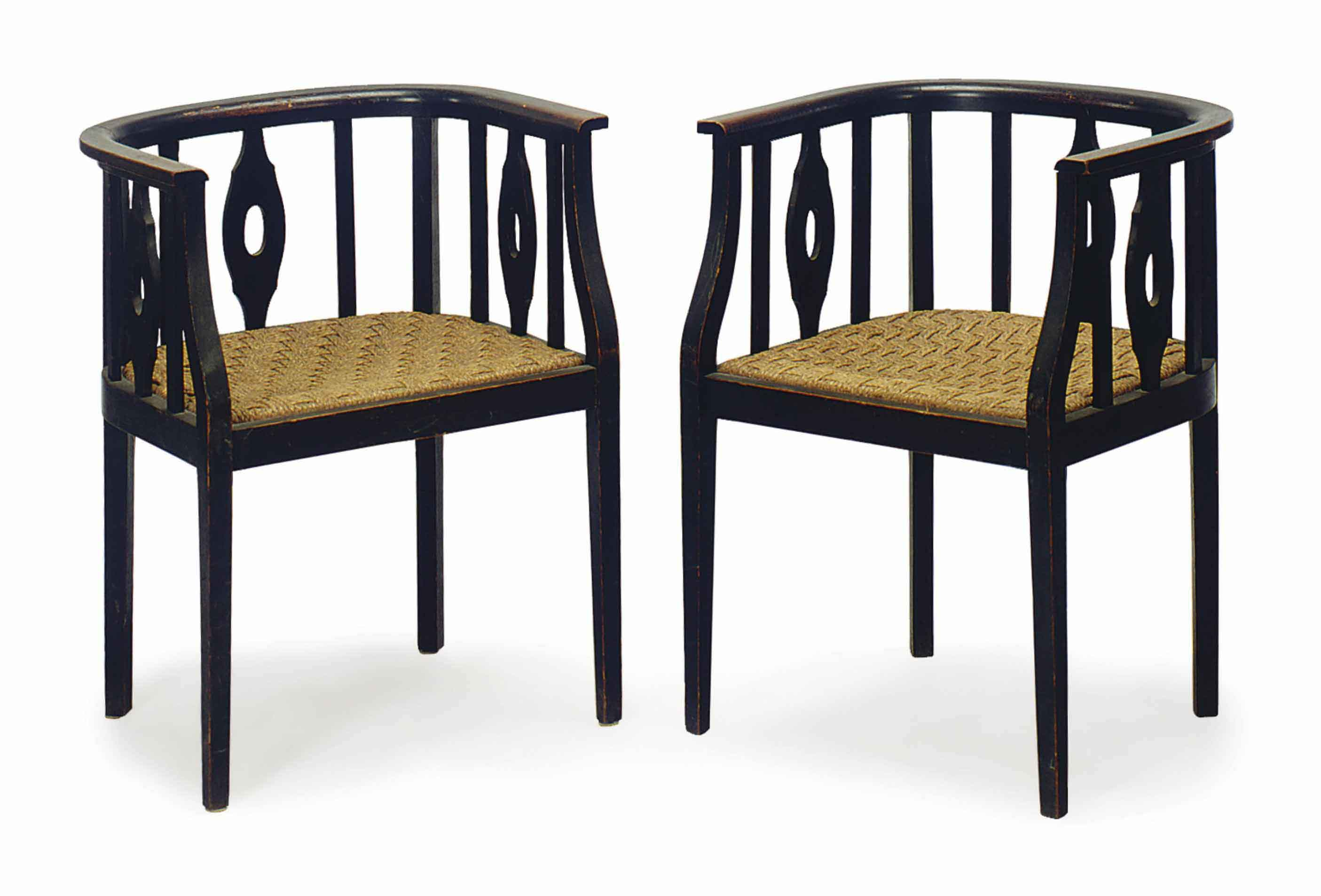 A PAIR OF CONTINENTAL EBONIZED AND WOVEN ROPE-SEAT BARRELBACK ARMCHAIRS,