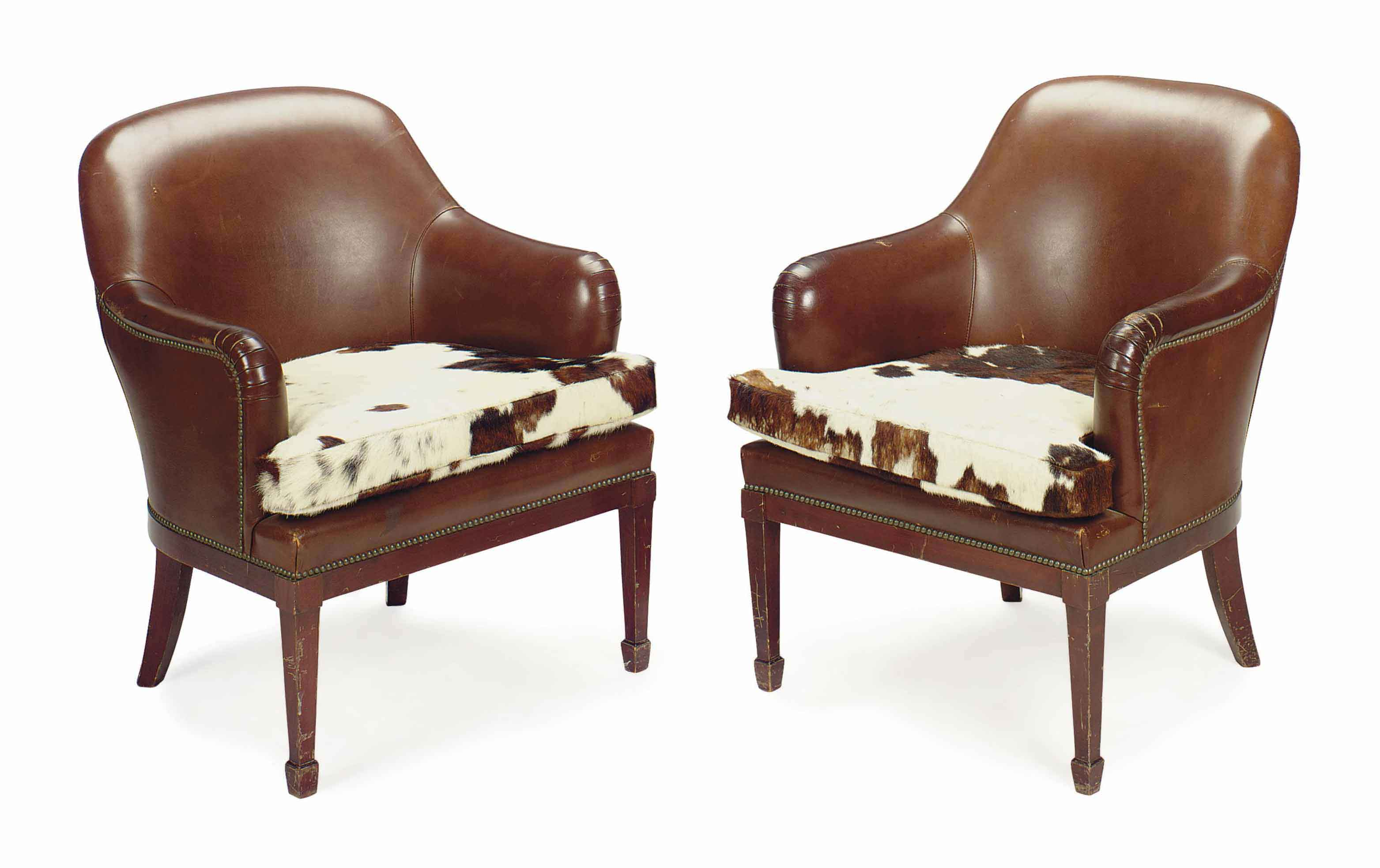 A PAIR OF FRENCH BROWN LEATHER AND COWHIDE CLUB CHAIRS,