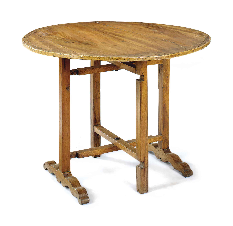 A CONTINENTAL WALNUT CIRCULAR TILT-TOP TABLE,