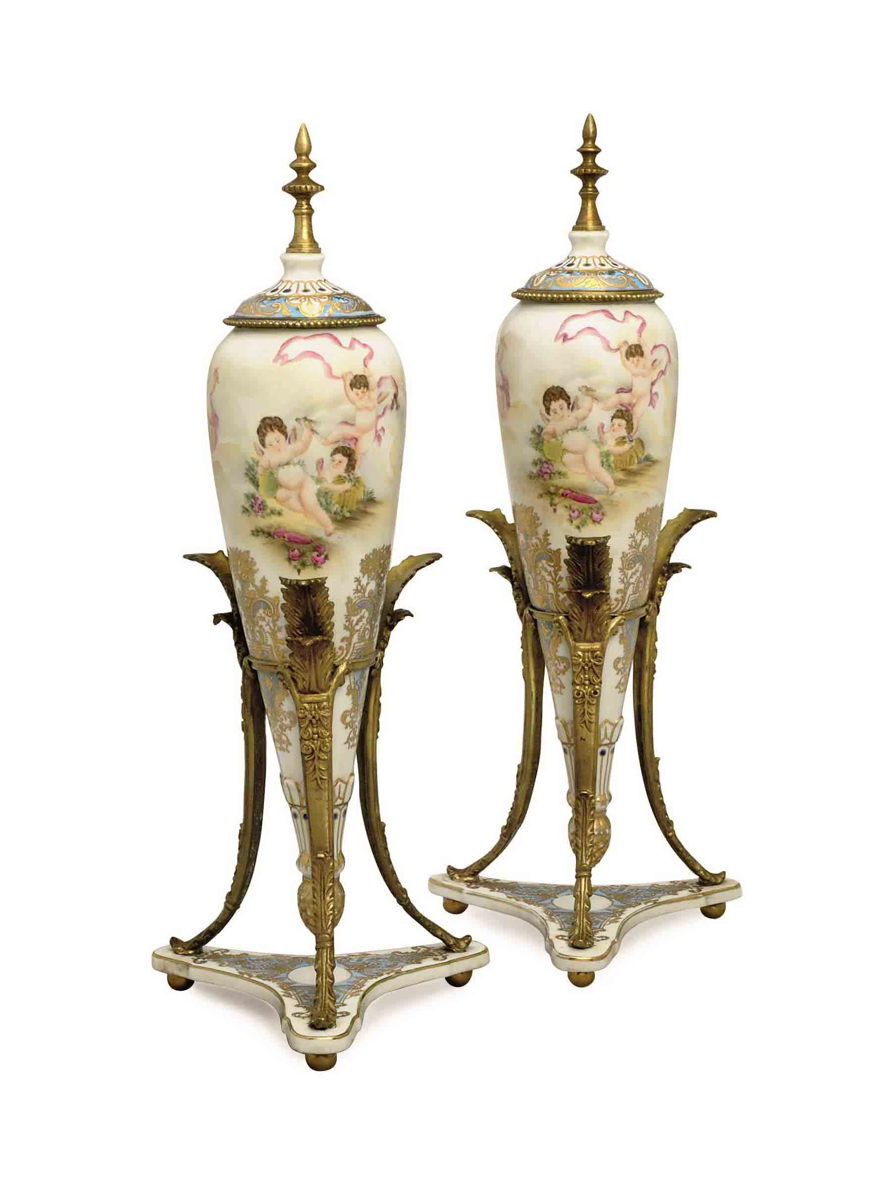 A PAIR OF PATINATED-BRONZE MOU