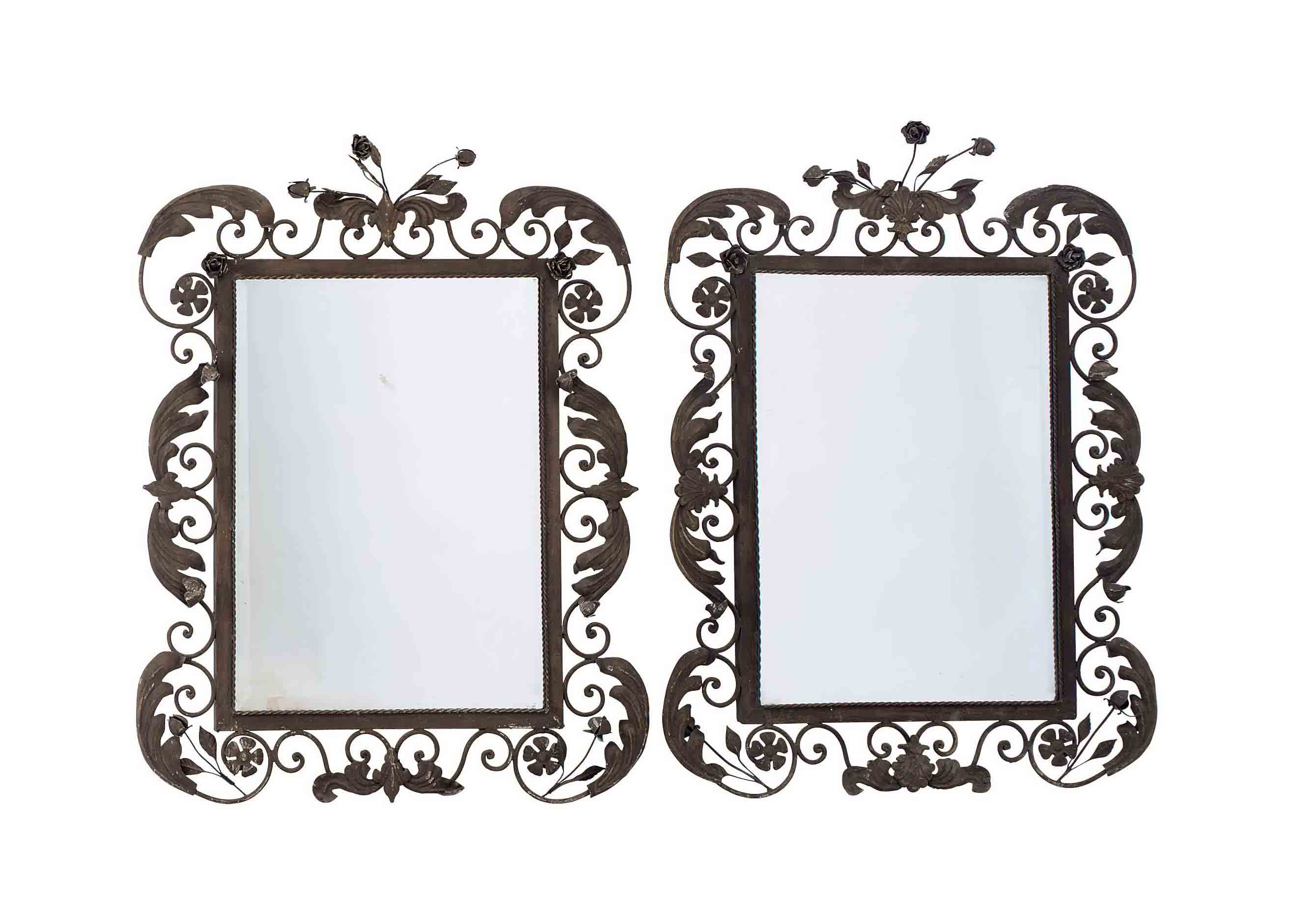 A PAIR OF WROUGHT-IRON MIRRORS