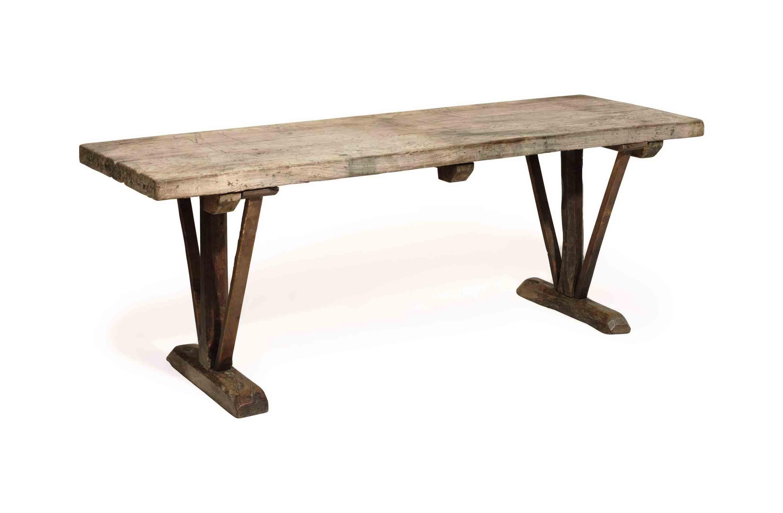 A WALNUT TRESTLE TABLE,