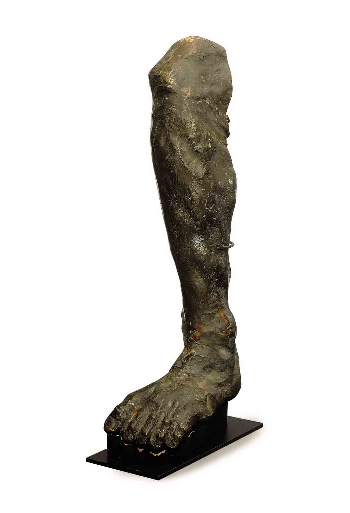 A PATINATED-BRONZE MODEL OF A