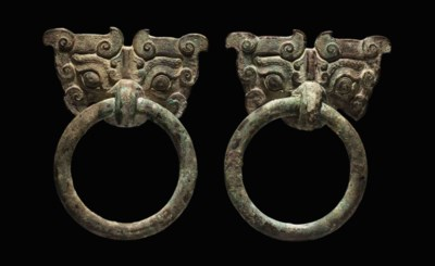 A PAIR OF BRONZE MASK AND RING