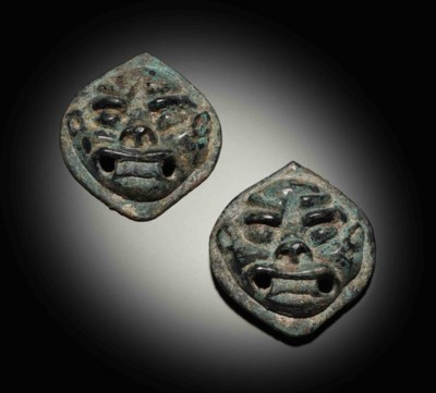 A PAIR OF UNUSUAL BRONZE MASK-