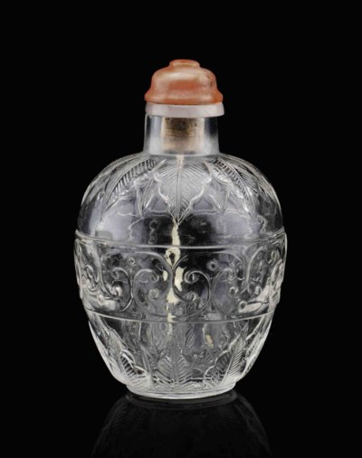 A RARE CARVED CLEAR GLASS SNUF