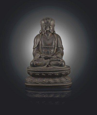 A BRONZE FIGURE OF A SEATED LU