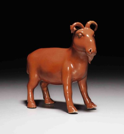 A CORAL-RED-GLAZED FIGURE OF A