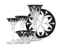 AN AMERICAN CUT AND ETCHED BLACK CASED COLORLESS GLASS DINNER SERVICE IN THE POUSSIN PATTERN,