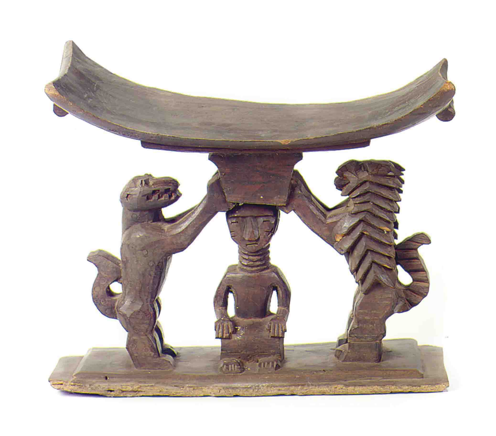 An African Carved Wood Stool With Rampant Feline Supports