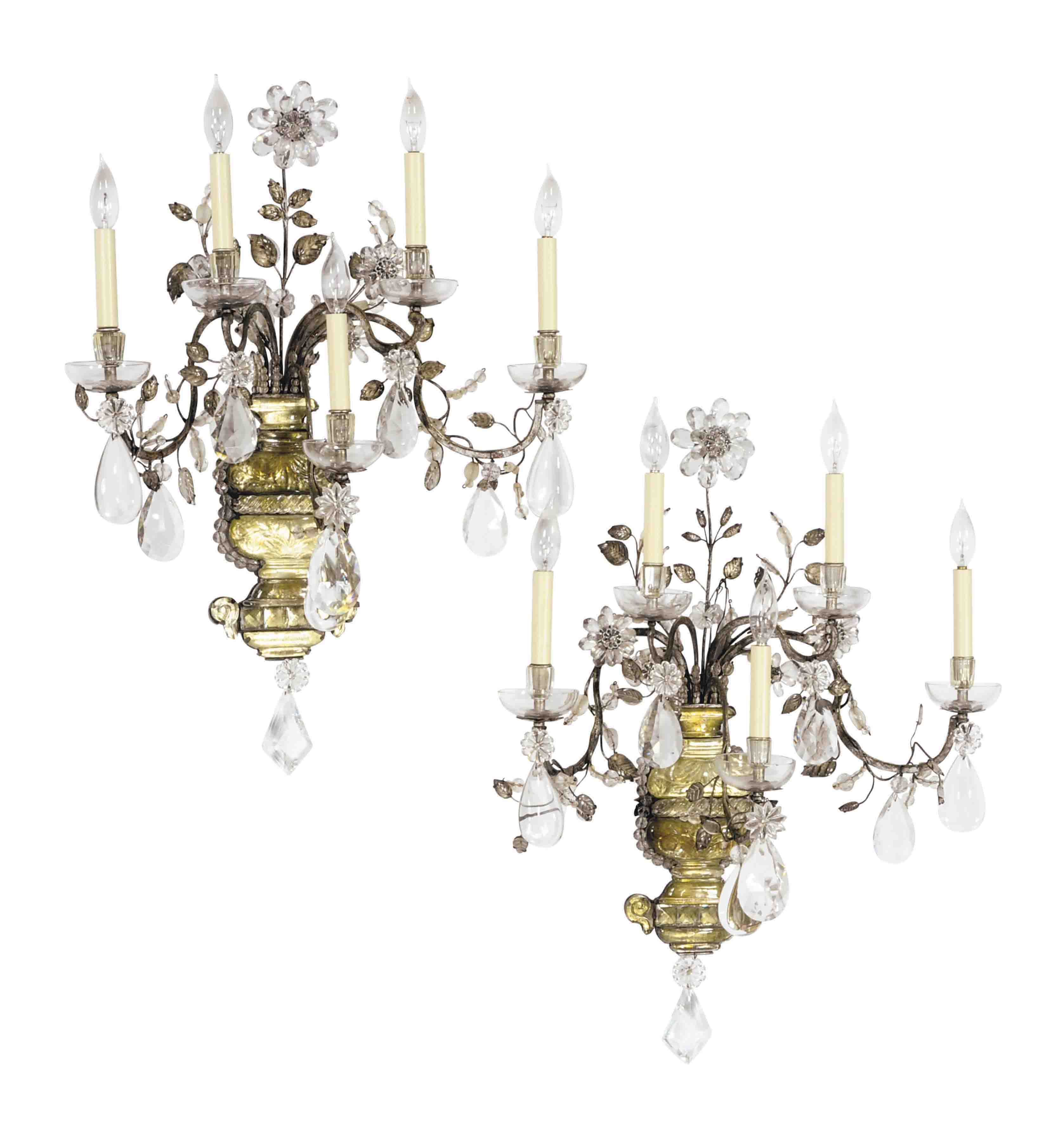 A PAIR OF SILVERED METAL AND CUT GLASS FIVE LIGHT WALL APPLIQUES,
