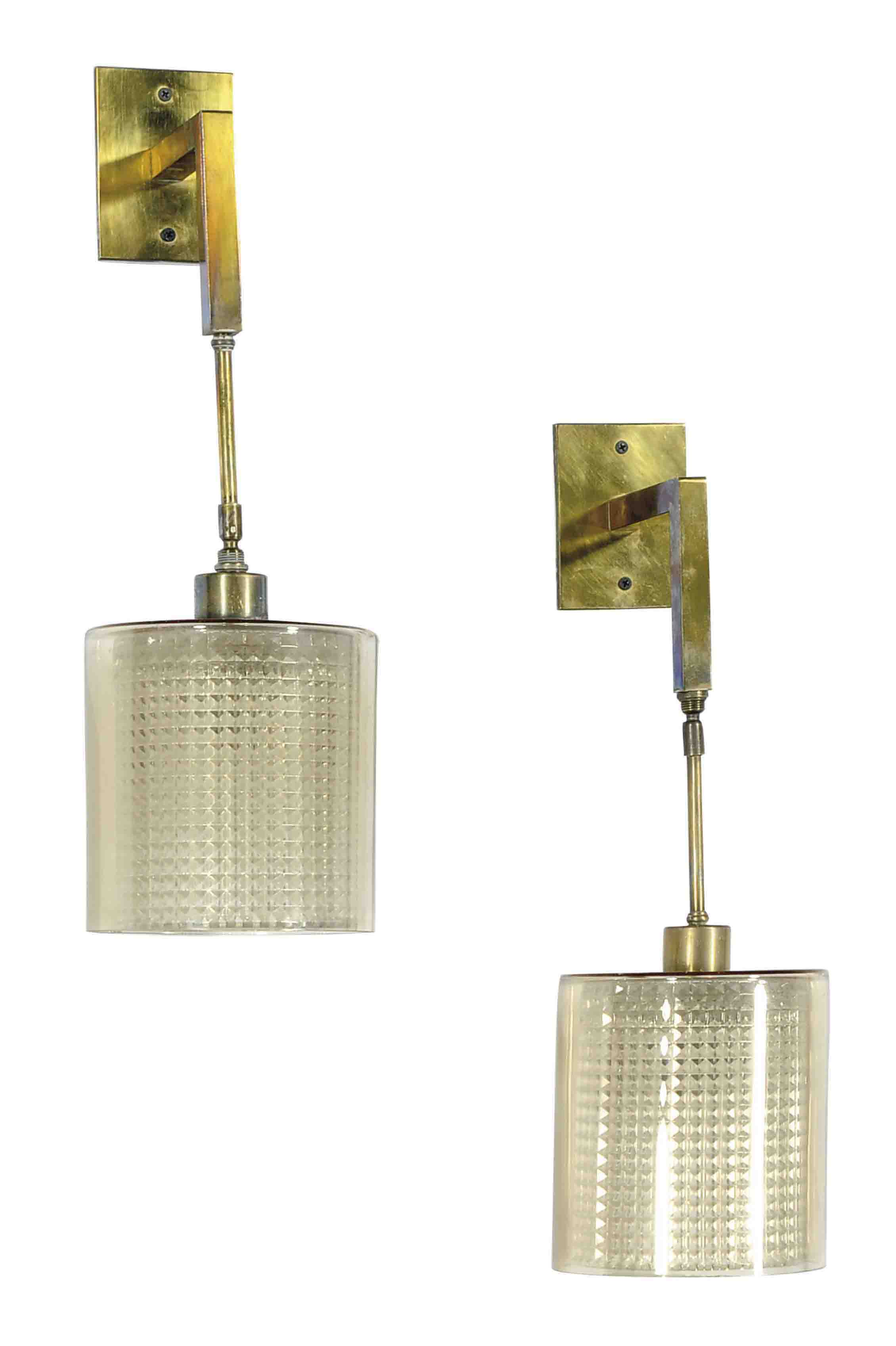 A SET OF THREE AMBER AND COLORLESS GLASS WALL LIGHTS,
