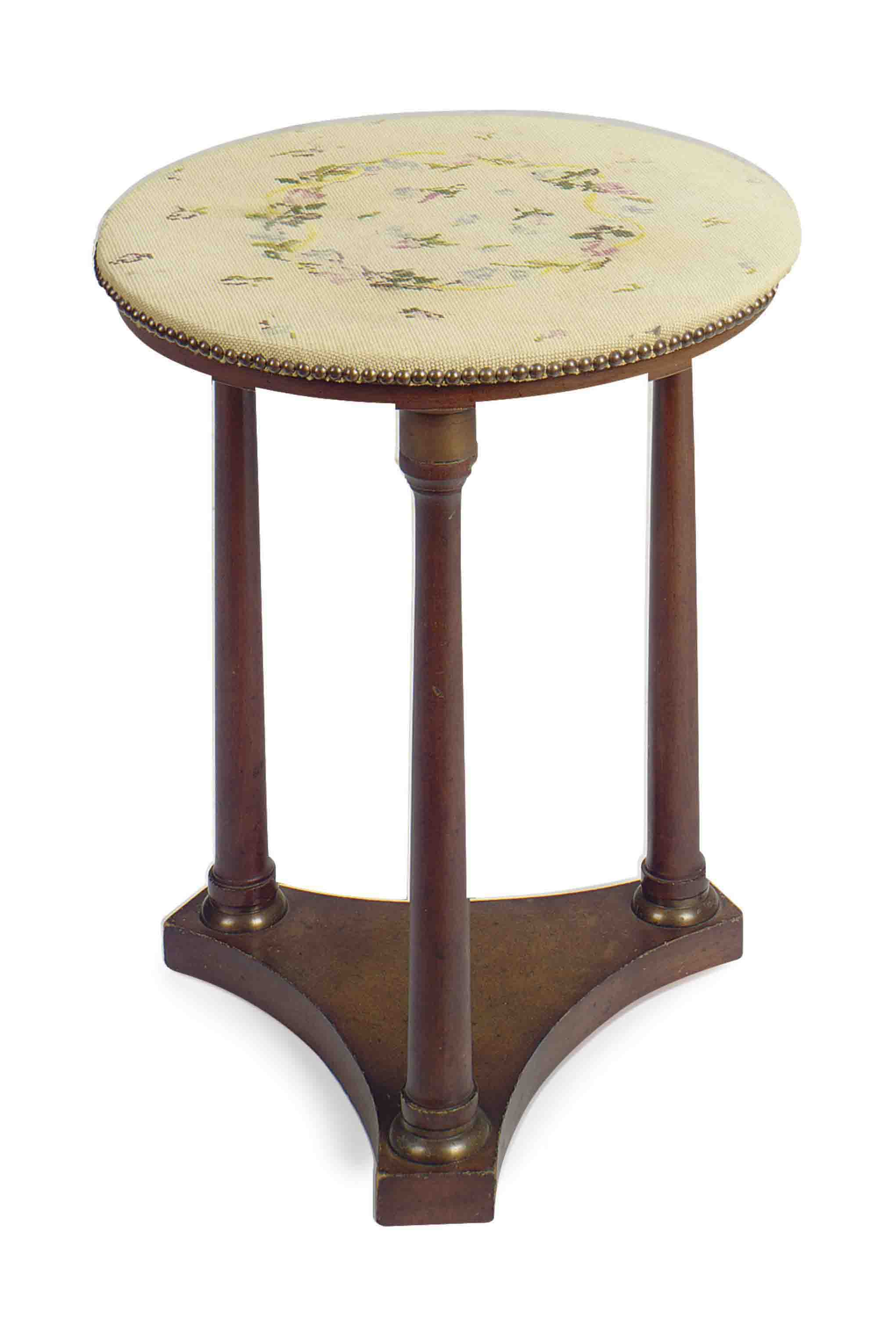 A CONTINENTAL BRASS-MOUNTED MAHOGANY AND NEEDLEWORK-COVERED SIDE TABLE,