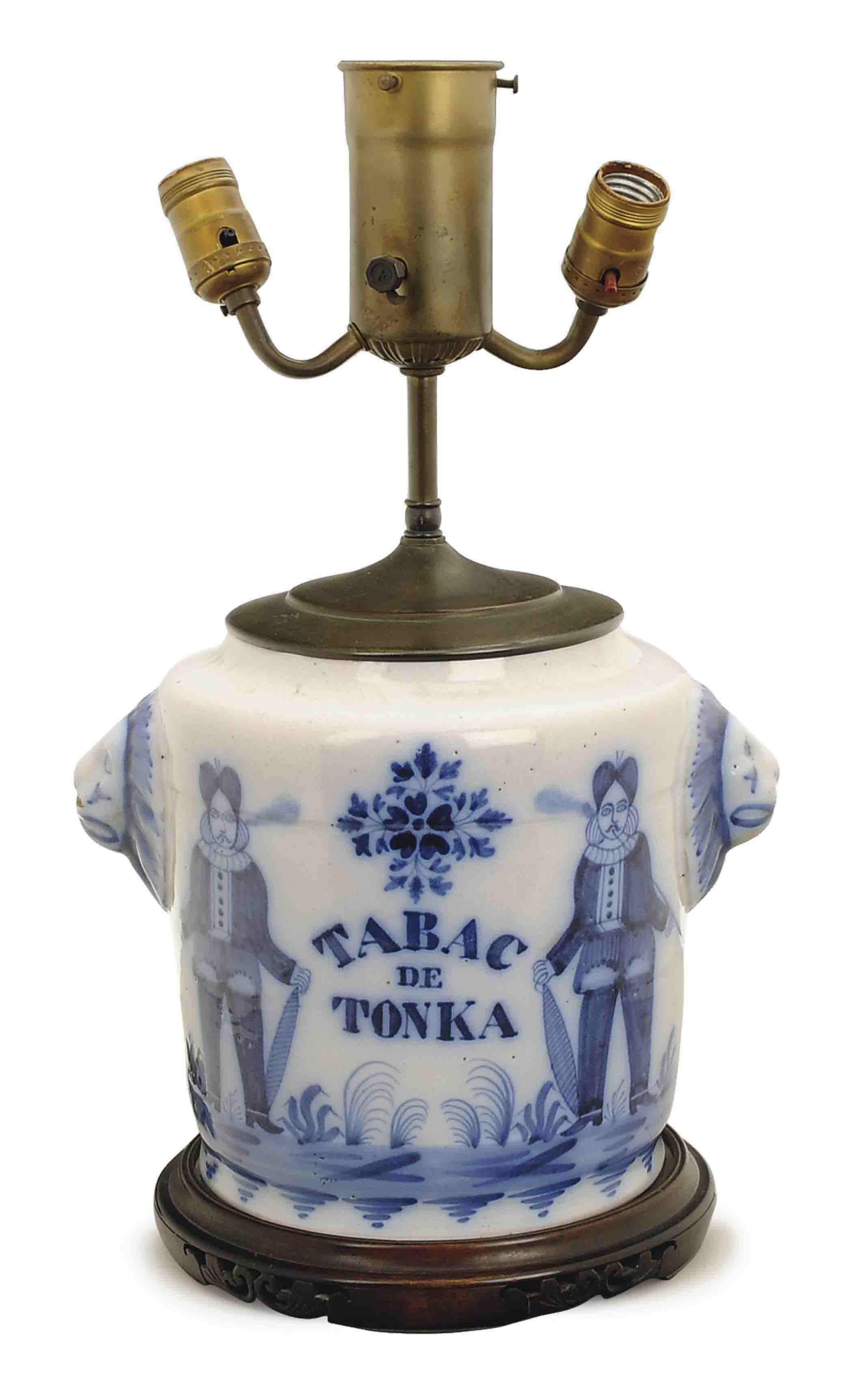 A BLUE-AND-WHITE POTTERY TOBACCO JAR MOUNTED AS A LAMP,