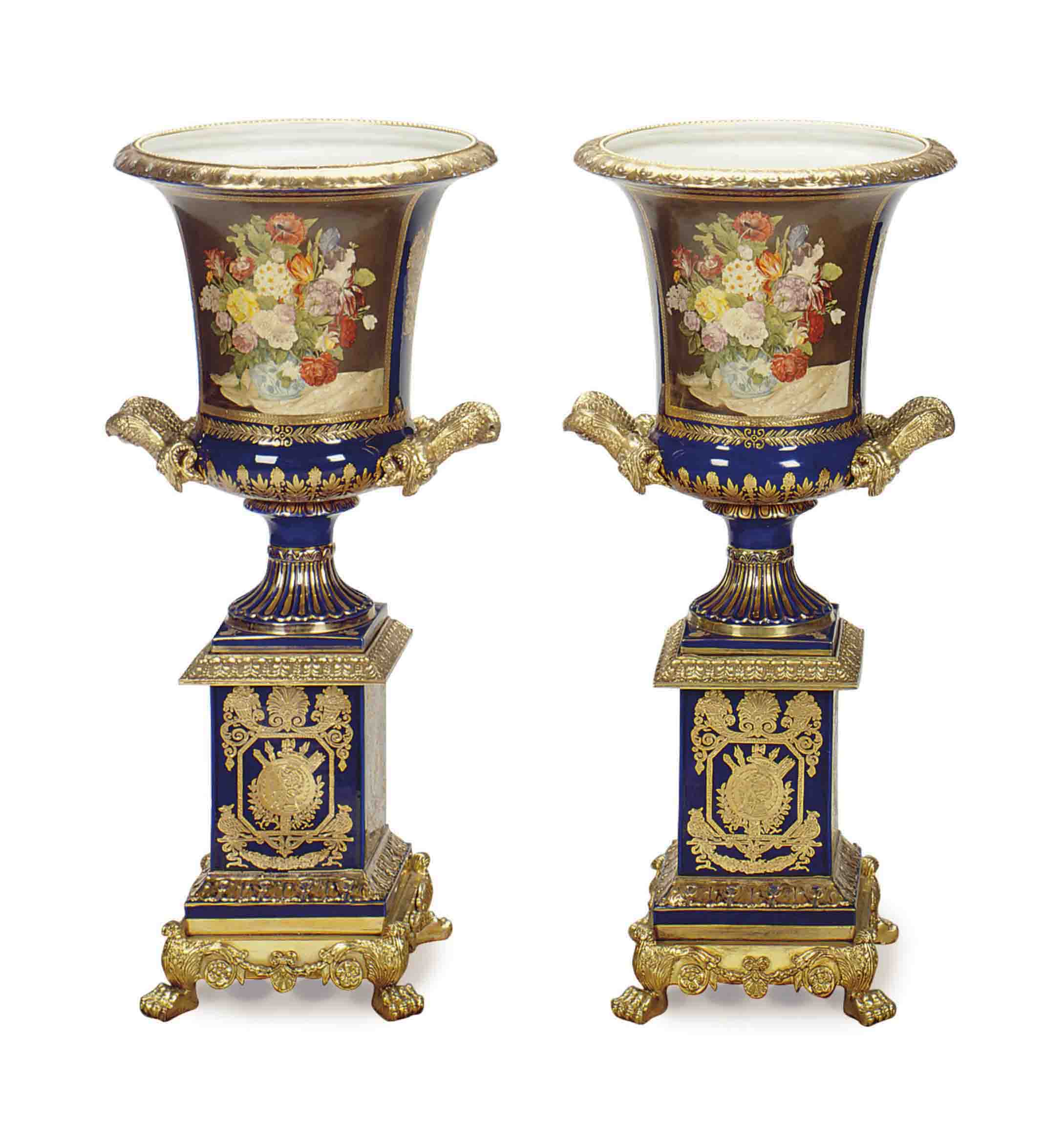 A PAIR OF GILT-METAL MOUNTED BLUE GROUND PORCELAIN VASES,