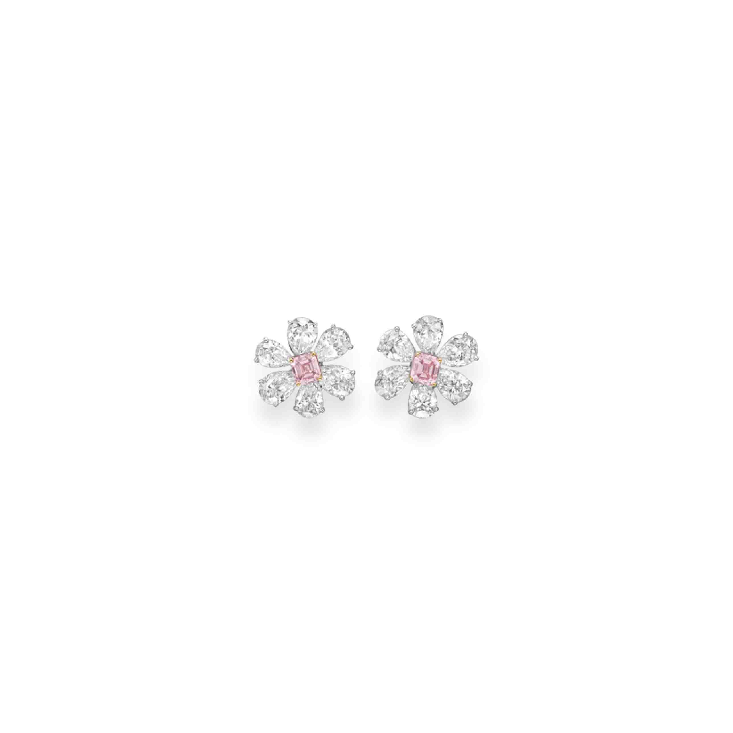 A PAIR OF COLORED DIAMOND AND DIAMOND EAR CLIPS