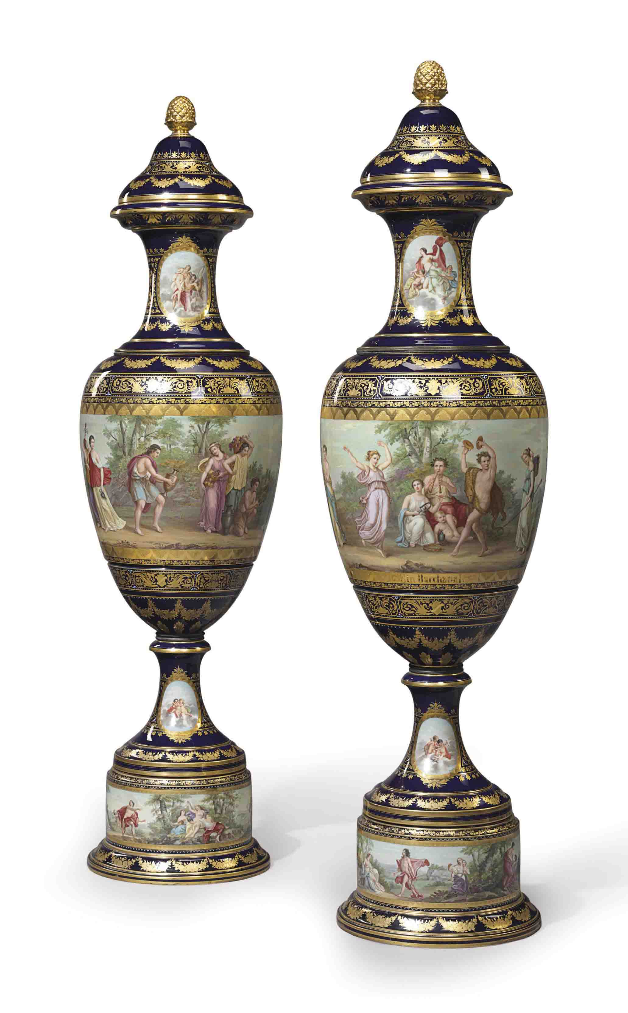 A PAIR OF MONUMENTAL VIENNA STYLE PORCELAIN COBALT-BLUE GROUND VASES AND COVERS, 'EIN BACCHANEL' AND 'EIN BACCHANTENZUG'