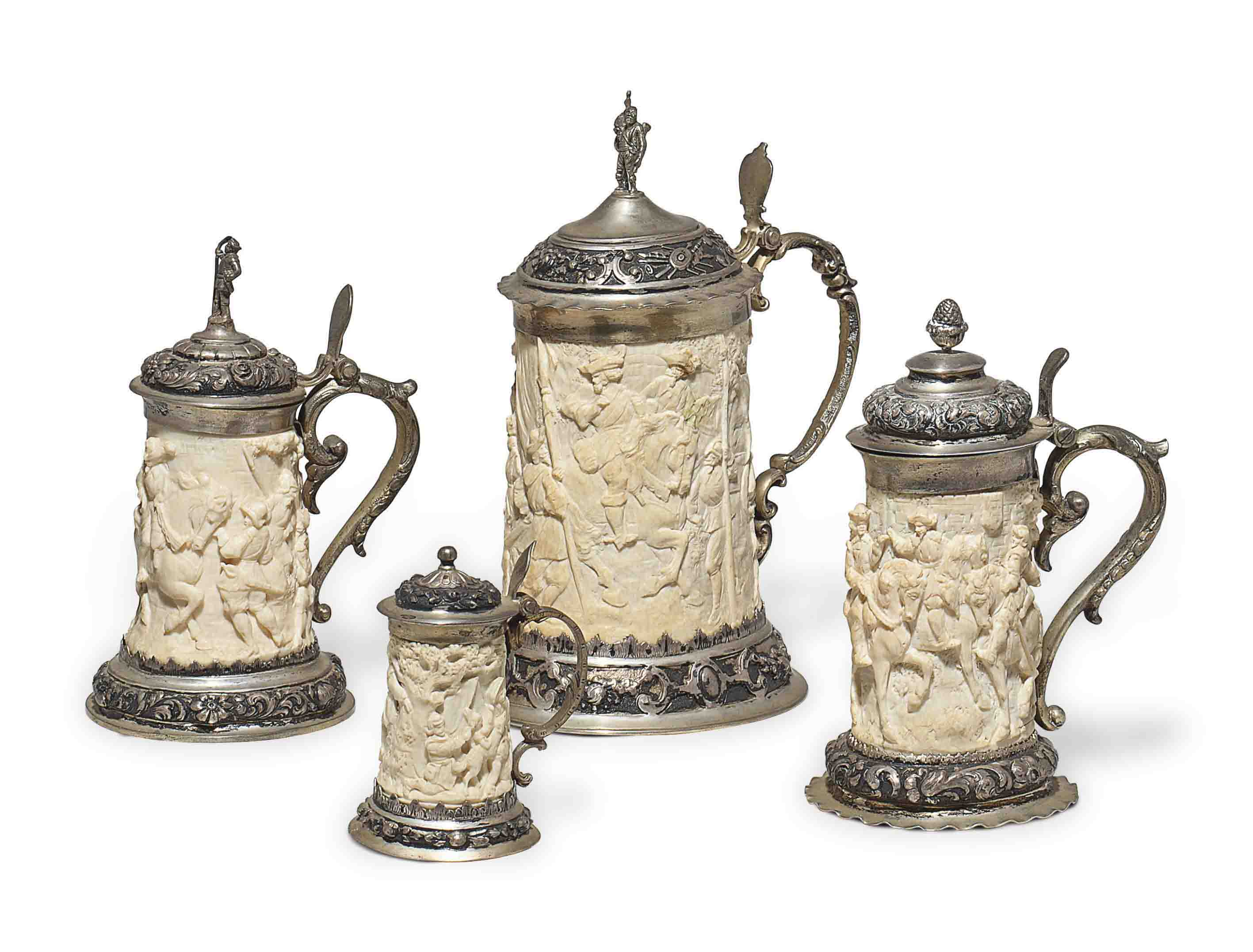 A GROUP OF FOUR GERMAN SILVER-MOUNTED IVORY TANKARDS