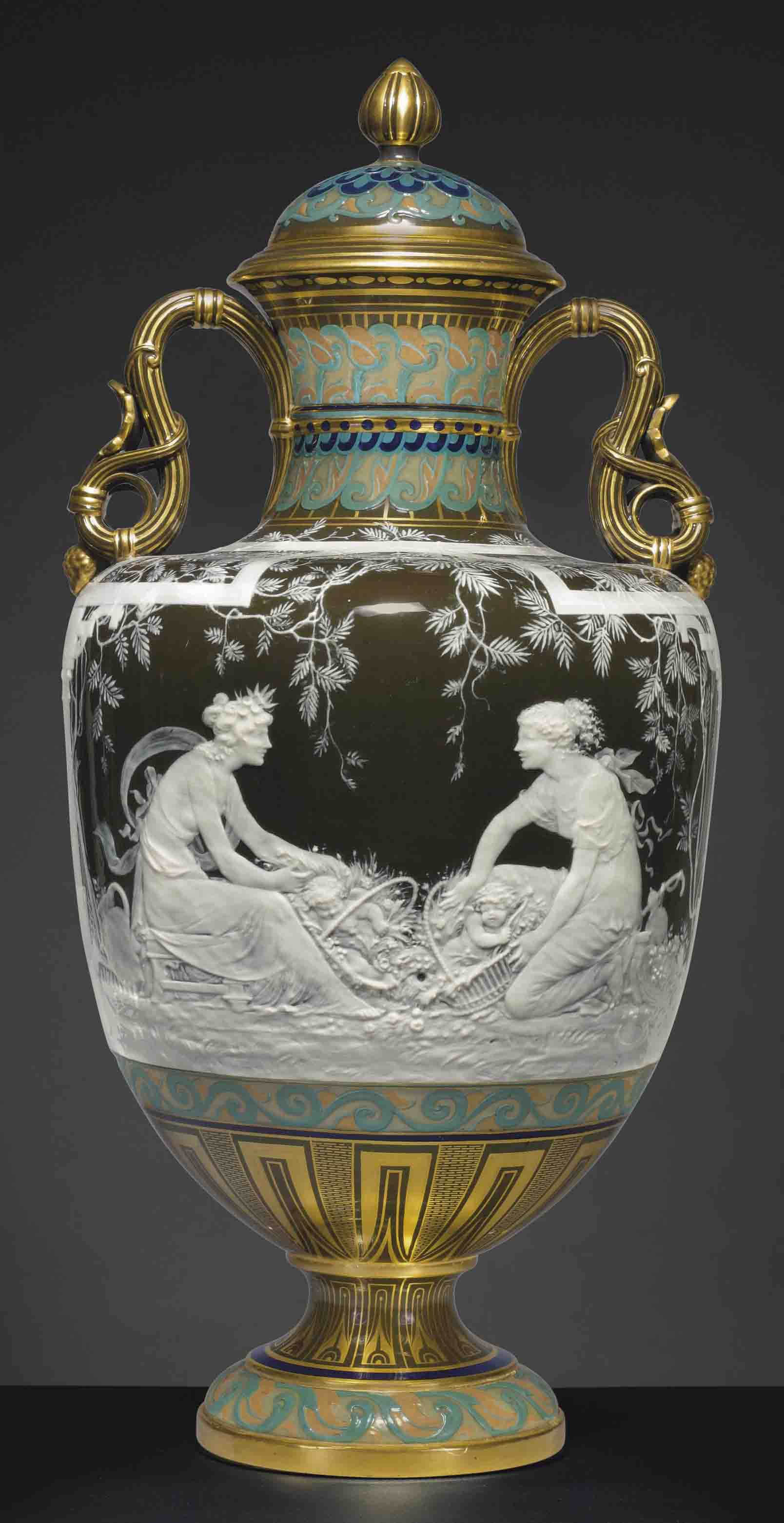 A Minton pâte-sur-pâteolive-brown two-handled vase and cover, 'Comparaison', circa 1892. 21⅛ in (53.6  cm) high (2). Sold for $134,500 on 20 October 2011 at Christie's in New York