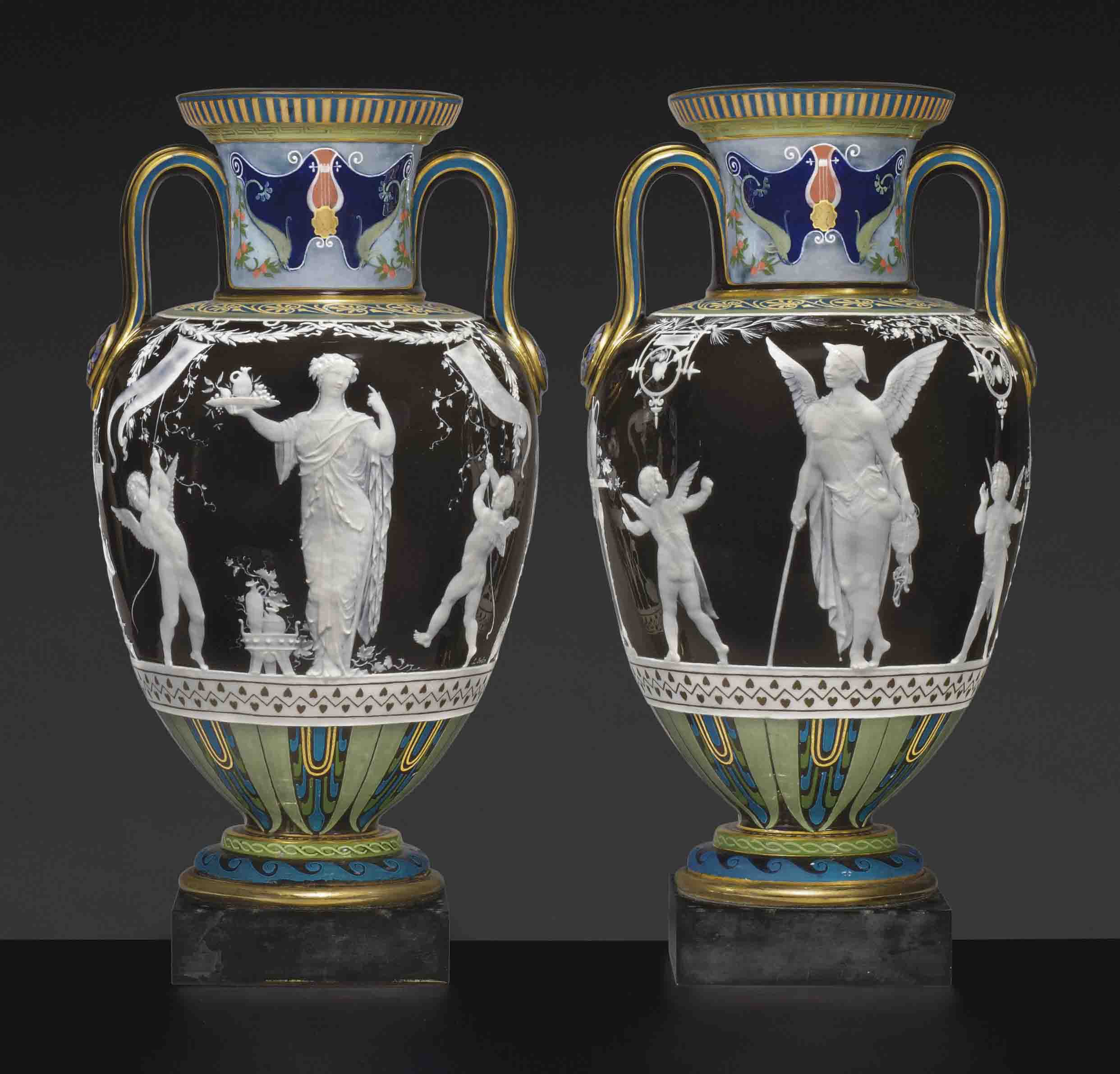 A PAIR OF MINTONS PATE-SUR-PATE BLACK AND CHOCOLATE-BROWN TWO-HANDLED VASES ON BLACK BELGIAN MARBLE BASES, 'VOYAGEUR & HOSTESSE'
