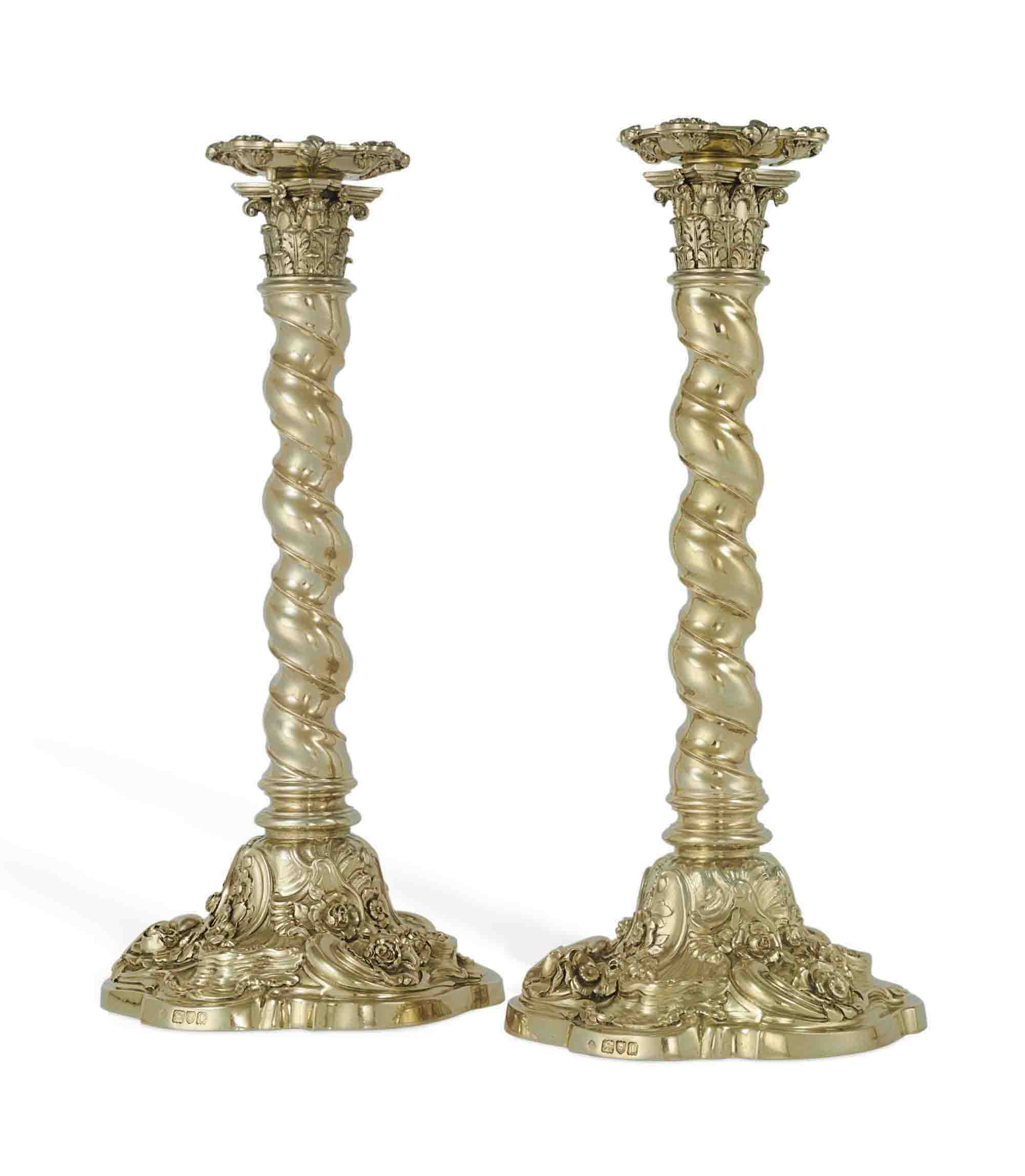 A PAIR OF GEORGE V SILVER-GILT CANDLESTICKS