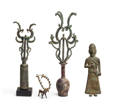FOUR IRANIAN BRONZE OBJECTS