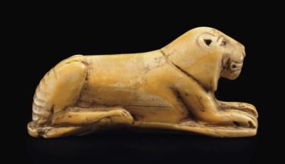 AN EGYPTIAN HIPPOPOTAMUS IVORY