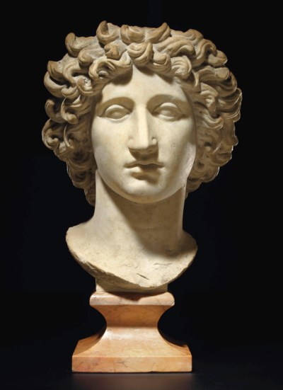A ROMAN MARBLE HEAD OF SOL