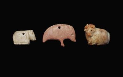 THREE MESOPOTAMIAN STONE AMULE