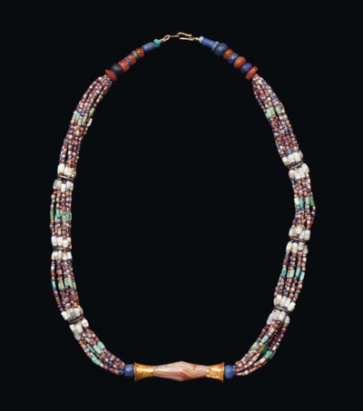 A BACTRIAN GOLD AND STONE BEAD
