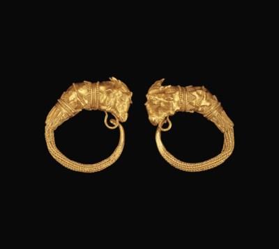 A PAIR OF GREEK GOLD GOAT HEAD