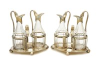 A PAIR OF GEORGE III SILVER AND GLASS CRUET SETS,