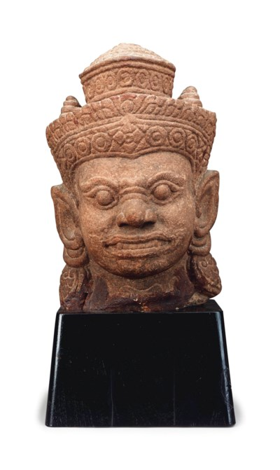 A KHMER CARVED STONE HEAD OF A