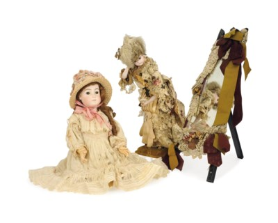 A FRENCH BISQUE AUTOMATON DOLL