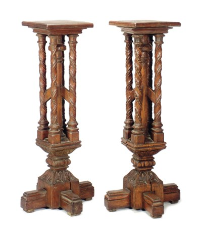 A PAIR OF CARVED OAK PEDESTALS
