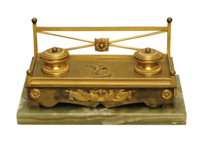 A FRENCH GILT-BRONZE AND ONYX